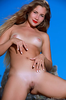 Mary Rock in Feather by Matiss outdoor sunny blonde blue eyes shaved pussy custom