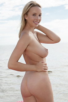 Agatha in Swan Float by Koenart outdoor sunny beach blonde brown eyes boobies busty shaved pussy custom