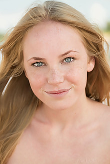 Runa in Natyce by Tora Ness outdoor sunny beach blonde blue eyes shaved freckles custom latest