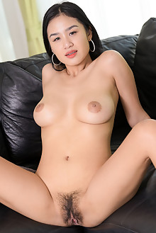 Kahlisa in Joy On The Couch by Robert Graham asian indoor br...