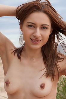 Lena Raz in Lena Raz by Koenart outdoor beach redhead brown eyes shaved