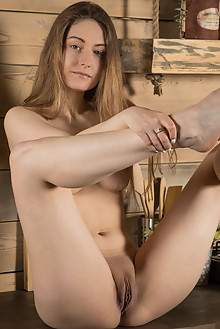 Katty Muss in The Cabin by Ron Offlin indoor blonde green ey...