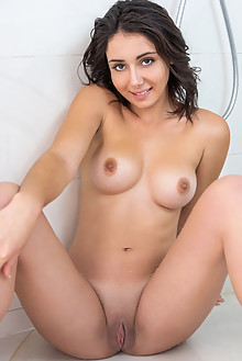 Dionisia in Wet by Tora Ness indoor brunette black hair brown eyes boobies wet shaved pussy custom