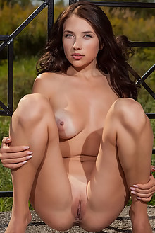 Niemira in Brick by Nudero outdoor sunny brunette blue eyes boobies shaved pussy