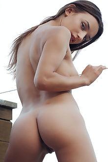 gloria sol new model presenting arkisi outdoor brunette green eyes boobies pussy