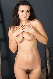 Presenting Sanita by Stan Macias indoor brunette black hair boobies hairy unshaven pussy bush