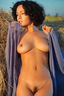 Pammie Lee in Conalmi by Nudero outdoor sunny sunset fields ebony brunette black hair brown eyes boobies hairy unshaven pussy tight latest