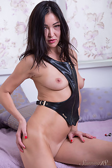 Rusya in Lady In Leather by Thierry Murrell indoor asian bru...