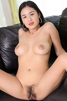 Kahlisa in Joy On The Couch by Robert Graham indoor asian br...