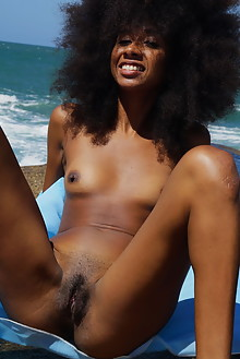 Presenting Isadora by Oliver Nation outdoor seaside beach sunny ebony small tits trimmed pussy ass